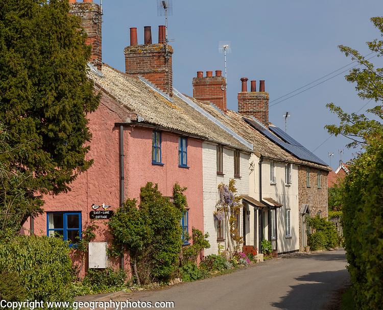 Row of pretty historic cottages, East Lane, Bawdsey, Suffolk, England, UK