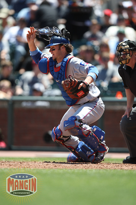 SAN FRANCISCO - JUNE 21:  Jarrod Saltalamacchia #21 of the Texas Rangers chases a bunt against the San Francisco Giants during the game at AT&T Park on June 21, 2009 in San Francisco, California. Photo by Brad Mangin