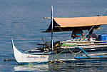 Aquarium trade fishermen on huka. Paint compressor supplies air to the fishermen who can stay underwater long to catch ornamental fish. Verde Island, Mindoro, Philippines