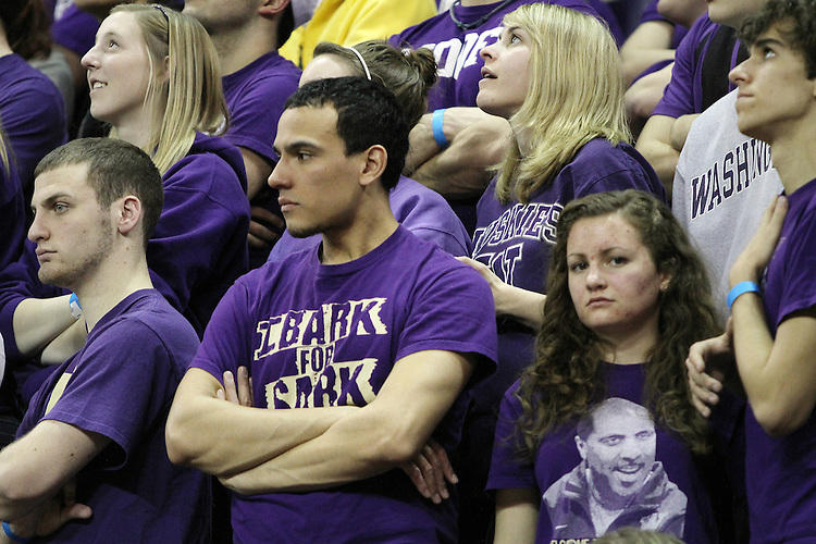 Unhappy Washington fans watch the closing moments of the game during the Washington State Cougars 80-69 road victory over their arch-rival Huskies at the Alaska Airlines Arena in Seattle, Washington, on February 27, 2011.  With the victory, head coach Ken Bone and the Cougars swept the regular season series from the Huskies, two games to none.