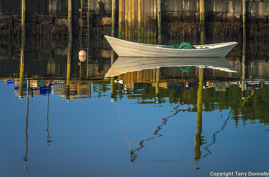 Stonington, Maine:<br /> Morning sun on white boat and wharf reflections, Stonington Harbor