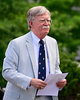 National Security Advisor John R. Bolton walks to a network interview on the North Driveway of the White House in Washington, DC on Wednesday, July 31, 2019. Photo Credit: Ron Sachs/CNP/AdMedia