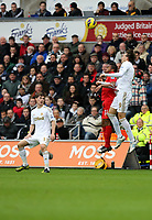Sunday, 25 November 2012<br /> Pictured: Ben Davies (L), Raheem Sterling (C) and Michu (R).<br /> Re: Barclays Premier League, Swansea City FC v Liverpool at the Liberty Stadium, south Wales.
