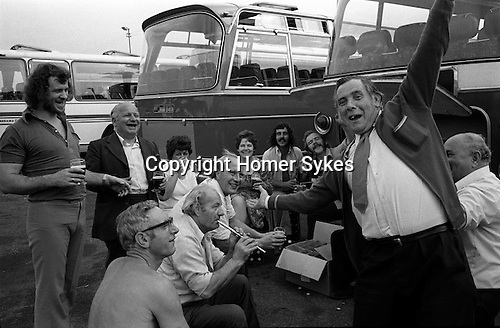 The Works Outing, coach trip.  Southend on Sea, Essex. England. 1974 A man playing a Penny Whistle.