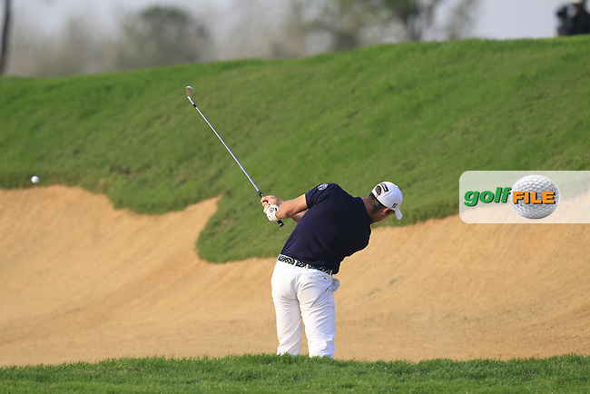 Romain Wattel (FRA) plays his 2nd shot from a fairway bunker on the 16th hole during Sunday's Final Round of the 2014 BMW Masters held at Lake Malaren, Shanghai, China. 2nd November 2014.<br /> Picture: Eoin Clarke www.golffile.ie