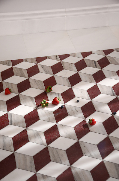 Euclid Grand, a hand-cut mosaic, shown in polished Red Lake, polished Afyon White and honed Horizon, is part of the Illusions® collection by New Ravenna.