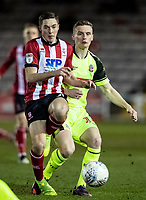 Bolton Wanderers' Ethan Hamilton competing with Lincoln City's Conor Coventry (left) <br /> <br /> Photographer Andrew Kearns/CameraSport<br /> <br /> The EFL Sky Bet League One - Lincoln City v Bolton Wanderers - Tuesday 14th January 2020  - LNER Stadium - Lincoln<br /> <br /> World Copyright © 2020 CameraSport. All rights reserved. 43 Linden Ave. Countesthorpe. Leicester. England. LE8 5PG - Tel: +44 (0) 116 277 4147 - admin@camerasport.com - www.camerasport.com