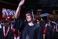 NWA Democrat-Gazette/BEN GOFF @NWABENGOFF<br /> Katie Renbold of St. Louis, graduating with a master of arts in teaching, waves to family Saturday, May 11, 2019, during the University of Arkansas all university commencement ceremony in Bud Walton Arena in Fayetteville.