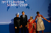 Pittsburgh, PA - September 24, 2009 -- United States President Barack Obama (2L) and U.S. first lady Michelle Obama (R) welcome Indian Prime Minister Manmohan Singh (L) and his wife Gursharan Kaur to the opening dinner for G-20 leaders at the Phipps Conservatory on Thursday, September 24, 2009 in Pittsburgh, Pennsylvania. Heads of state from the world's leading economic powers arrived today for the two-day G-20 summit held at the David L. Lawrence Convention Center aimed at promoting economic growth. .Credit: Win McNamee / Pool via CNP