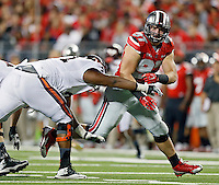 Ohio State Buckeyes defensive lineman Joey Bosa (97) gets blocked by a Virginia Tech Hokies linemen during the 2nd quarter of their game in Ohio Stadium on September 6, 2014.  (Dispatch photo by Kyle Robertson)