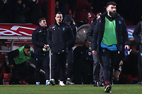 Aston Villa Assistant Coach, John Terry, walks towards the dressing room at the end of the match after losing to a late goal during Brentford vs Aston Villa, Sky Bet EFL Championship Football at Griffin Park on 13th February 2019