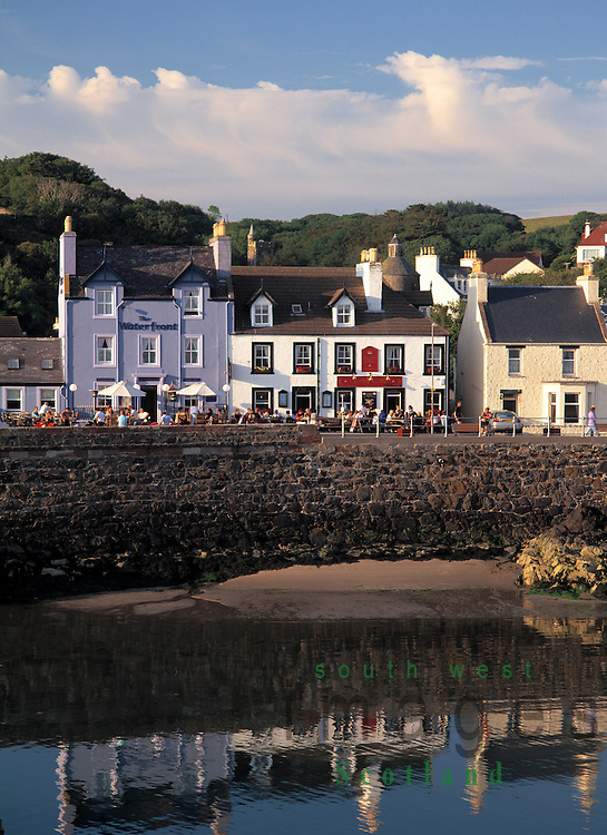 The seafront Portpatrick looking across from Dorn Rock to hotels and guest houses catching the summer evening light in the Rhins of Galloway Scotland UK