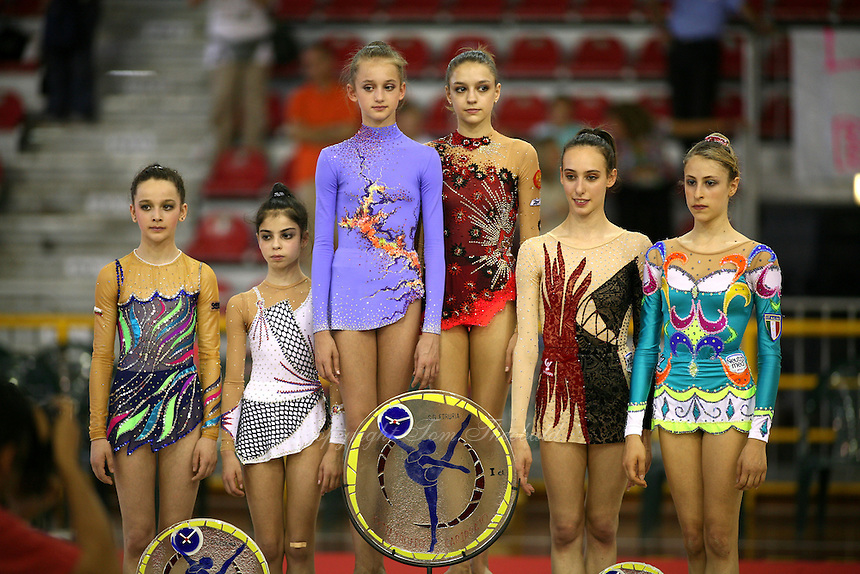 (L-R)Receiving team winner awards are...Monica Mincheva and Filipa Siderova of Bulgaria(2nd), Natalia Pichuzhkina and Evgeniya Kanaeva or Russia, Romina Laurito and Chiara Ianni of Italy .. celebrate at 2006 Trofeo Cariprato in Prato, Italy on June 17, 2006.  (Photo by Tom Theobald)
