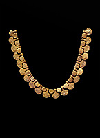 Mycenaean gold necklace with waz lily shaped beads from the Mycenaean cemetery of Midea tomb 10, Dendra, Greece. National Archaeological Museum Athens Cat no 8748. Black Background