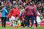 Arsenal's Pierre-Emerick Aubameyang walks past the West Ham team without shaking their hands before the Premier League match at the Emirates Stadium, London. Picture date: 7th March 2020. Picture credit should read: Paul Terry/Sportimage