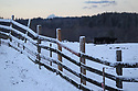 Split rail wooden fence with snow