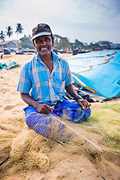Portrait of a fisherman working in Negombo fish market (Lellama), Sri Lanka, Asia. This is a portrait photo of a fisherman working in Negombo fish market (Lellama), Sri Lanka, Asia. Negombo fish market, known as Lellama is the second biggest fish market is Sri Lanka.