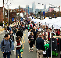 Photography of Small Business Saturday in historic South End Charlotte, North Carolina.  More than 150 pop-up shops lined the street  showcasing local small business owners in Charlotte. Small Business Saturday started 10 years ago to encourage people to shop small.<br /> <br /> Charlotte photographer - PatrickSchneiderPhoto.com