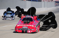 Nov 14, 2010; Pomona, CA, USA; NHRA funny car driver Bob Tasca III (right) after defeating Matt Hagan in the first round during the Auto Club Finals at Auto Club Raceway at Pomona. Mandatory Credit: Mark J. Rebilas-