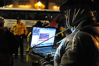 November 23, 2011, Toronto Police in significant numbers deploy during the predawn hours this morning, beginning the process of evicting the Occupy Toronto tent camp from St. James Park. Here an unidentified protest volunteer livestreams the event from his laptop.