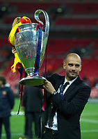 28.05.2011, Wembley Stadium, London, ENG, UEFA CHAMPIONSLEAGUE FINALE 2011, FC Barcelona (ESP) vs Manchester United (ENG), im Bild FC Barcelona's head coach Josep Guardiola celebrates with the European Cup trophy after thrashing Manchester United 3-1 during the UEFA Champions League Final at Wembley Stadium, EXPA Pictures © 2011, PhotoCredit: EXPA/ Propaganda/ Chris Brunskill *** ATTENTION *** UK OUT! <br /> Foto Insidefoto