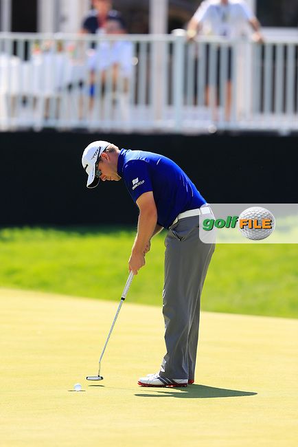Richie Ramsay (SCO) putts on the 16th green during Saturday's Round 3 of the 2013 Bridgestone Invitational WGC tournament held at the Firestone Country Club, Akron, Ohio. 3rd August 2013.<br /> Picture: Eoin Clarke www.golffile.ie