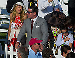 Kevin Plank (center, grey tweed suit) of Uner Armor and Sagamore Racing sets up to watch his horse, Tiger Walk, run in the Preakness Preakness Stakes at Pimlico Race Course on May 19, 2012