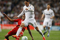 25.04.2012 SPAIN -  UEFA Champions League Semi-Final 2nd leg  match played between Real Madrid CF vs  FC Bayern Munchen 2 (1) - 1 (3) at Santiago Bernabeu stadium. The picture show Luiz Gustavo  (Midfielders Bayern Munchen) and Mesut Ozil (German midfielder of Real Madrid)