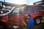 "QUEENS, NY -- NOVEMBER 18, 2013:  Jose ""Flaco"" Hernandez, 32, fixes a latch on the drivers side door of a 1998 Ford Explorer on November 18, 2013 in Queens.  PHOTOGRAPH BY MICHAEL NAGLE FOR THE NEW YORK TIMES"