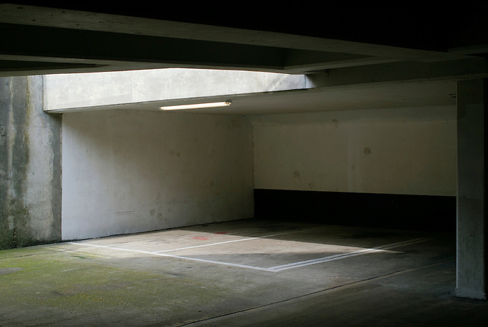 Empty underground parking spaces.