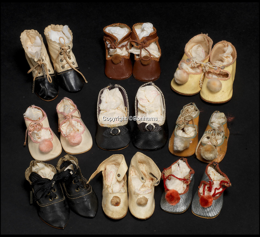 BNPS.co.uk (01202 558833)<br /> Pic: Bonhams/BNPS<br /> <br /> ***Please Use Full Byline***<br /> <br /> Nine pairs of dolls shoes. <br /> <br /> <br /> A creepy collection of almost 100 'lifelike' dolls modelled on children has emerged for sale with a whopping half a million pounds price tag. <br /> <br /> The eerie-looking toys were made in Germany in the early 20th century as dollmakers strived to produce dolls with realistic human features.<br /> <br /> The collection of 92 dolls, which includes some of the rarest ever made, has been pieced together by a European enthusiast over the past 30 years.<br /> <br /> It is expected to fetch upwards of £500,000 when it goes under the hammer at London auction house Bonhams tomorrow (Weds).