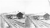 D&amp;RG Gunnison depot with eastbound passenger train - locomotive &amp; four coaches.<br /> D&amp;RG  Gunnison, CO  Taken by Nims, F. A. - 1882