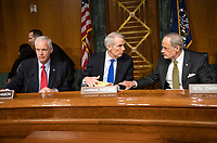 """United States Senator Ron Johnson (Republican of Wisconsin), left, US Senator Rob Portman (Republican of Ohio), center, and US Senator Tom Carper (Democrat of Delaware), right, prior to hearing testimony before the US Senate Committee on Homeland Security and Governmental Affairs Permanent Subcommittee on Investigations during a hearing on """"Examining Private Sector Data Breaches"""" on Capitol Hill in Washington, DC on Thursday, March 7, 2019.<br /> Credit: Ron Sachs / CNP/AdMedia"""