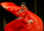 Tiffany Wan is a blur of motion as she performs a traditional Mongolian dance during the creative expression presentations at the 2006 Miss SEAFAIR Coronation Tuesday, July 25, 2006  at the Museum of History and Industry's McEachern Auditorium in Seattle. Jim Bryant/PI Photo..