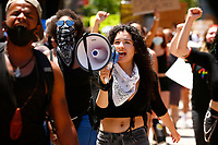 LeAndra Mira shouts through a megaphone as she helps lead a youth led march against police brutality and environmental racism in downtown where they marched from the City County Building and throughout the city on Tuesday June 16, 2020 in Pittsburgh, Pennsylvania. (Photo by Jared Wickerham/Pittsburgh City Paper)