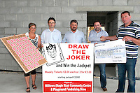 Damien Murphy of IC Engineering presents a cheque to Joe Daly at the launch of the 'Draw the Joker' jackpot lotto in aid of Milltown Community Centre and Playground.Also in the photo are Christine O'Brien, Noel Spillane and Don Myers.<br /> Photo by Sally MacMonagle.