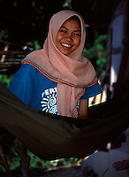 A pretty Muslim lady smiles for the camera wearing her traditional scarf.