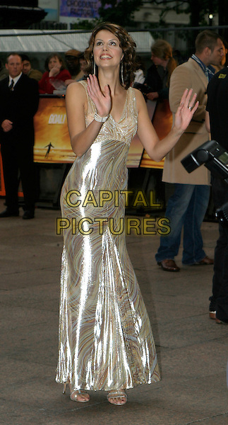BEVERLY TURNER.At The Goal Film Premiere held at the Odeon Cinema,.Leicestre Square,.London, 15th September 2005.full length long shiney silver gold metallic dress gown hands up palm.Ref: AH.www.capitalpictures.com.sales@capitalpictures.com.© Capital Pictures.