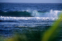 Beautiful blue waves rolling in the sea of Tanna Island, Vanuatu.