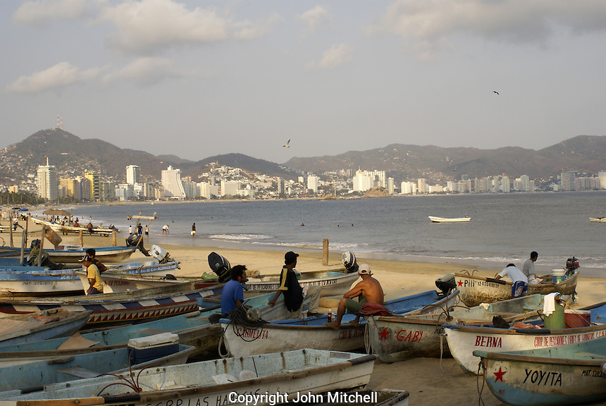 Fishermen relaxing on the beach in Acapulco, Mexico