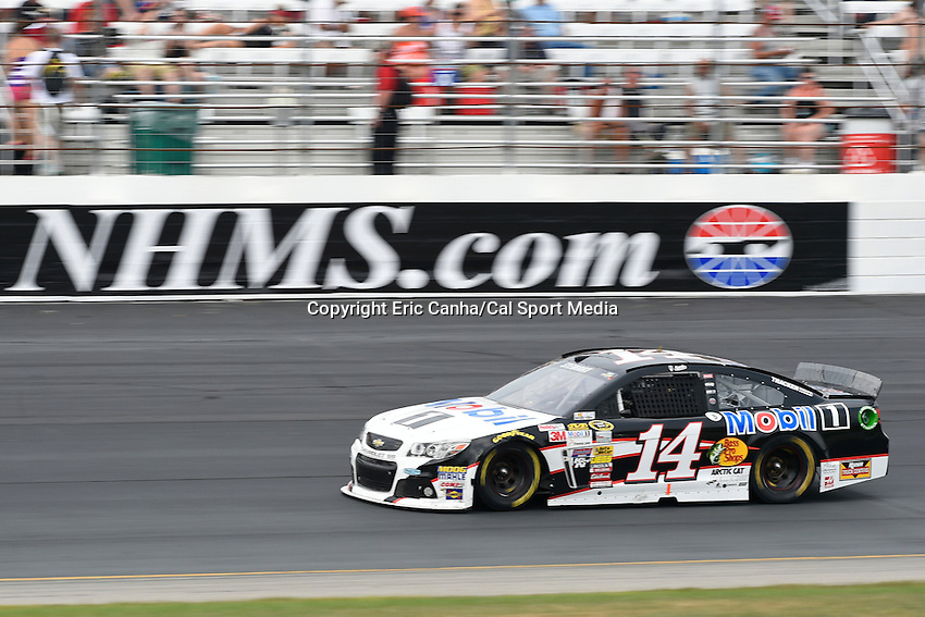 July 13, 2014 - Loudon, New Hampshire, U.S. - Sprint Cup Series driver Tony Stewart (14) races into turn 4 during the NASCAR Sprint Cup Series Camping World RV 301 race held at the New Hampshire Motor Speedway in Loudon, New Hampshire. Eric Canha/CSM