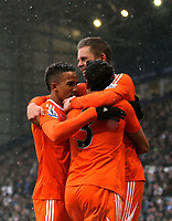Pictured: Gylfi Sigurdsson of Swansea (TOP) celebrating his equaliser with team mates L-R Scott Sinclair and Neil Taylor. Saturday, 04 February 2012<br />