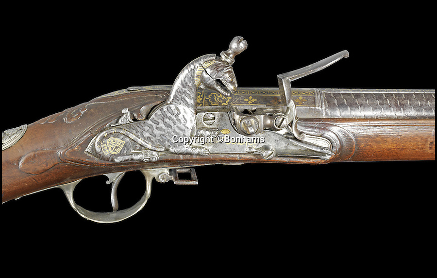BNPS.co.uk (01202 558833)<br /> Pic: Bonhams/BNPS<br /> <br /> Tigers burning bright - Astonishing £6 million sale of Tipu Sultan treasure.<br /> <br /> His own tiger themed shotgun sold for £722,000, well over its £150,000 estimate<br /> <br /> Wellington's first worthy adversary on his way to Waterloo.<br /> <br /> An incredible bounty of exotic artefacts looted from the defeated Indian ruler who set the young Duke of Wellington on the road to his Waterloo victory has sold for a whopping £6 million - Six times its estimate.<br /> <br /> The stunning relics were raided from the palace of Tipu Sultan in the heart of India in the wake of defeat by British forces led by 30-year-old army colonel Wellington in the late 18th century.<br /> <br /> Wellington, then a young Arthur Wellesley, earned his spurs and learned skills fighting Tipu that would later prove vital in defeating French dictator Napoleon on the battlefields of Waterloo over two decades later.<br /> <br /> In the wake of the victory, British soldiers pillaged the city and Tipu's palace, helping themselves to the wealthy sultan's gold, jewellery, arms and armour, clothing and even furniture plundered from the palace.<br /> <br /> London auctioneers Bonhams staged the auction of more than 30 items collected over three decades by British Tipu expert Robin Wigington.