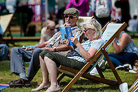 Tuesday 31 May 2016. Hay on Wye, UK<br /> Pictured: A couple relax in the sun at the Hay festival<br /> Re: The 2016 Hay festival take place at Hay on Wye, Powys, Wales
