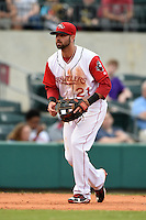Arkansas Travelers third baseman Kaleb Cowart (21) during a game against the San Antonio Missions on May 24, 2014 at Dickey-Stephens Park in Little Rock, Arkansas.  Arkansas defeated San Antonio 4-2.  (Mike Janes/Four Seam Images)