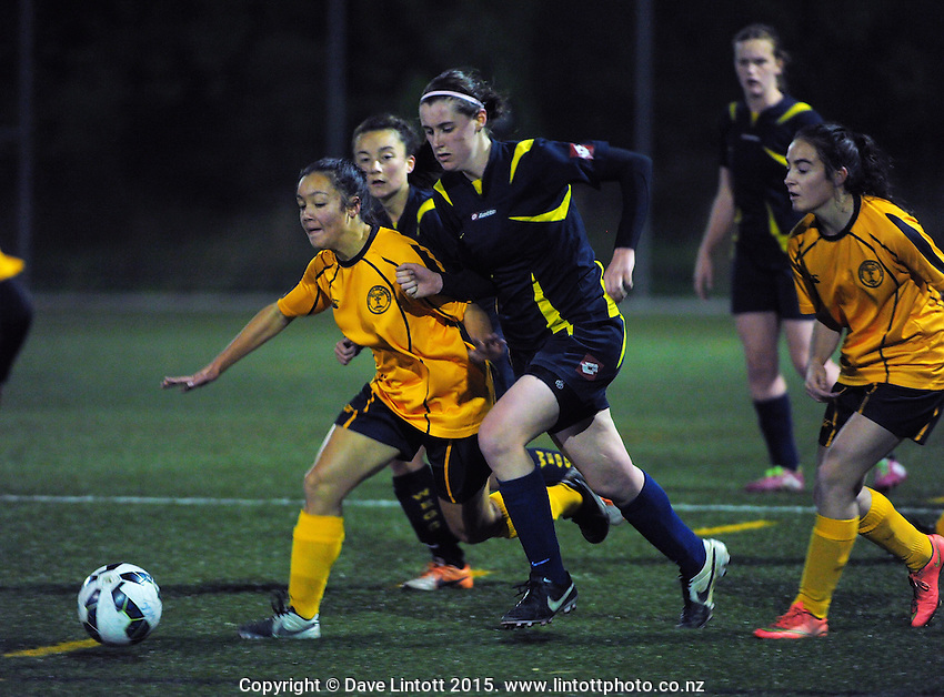 Action from the Wellington division one girls' football match between Wellington Girls' College (black with yellow stripes) and Wellington East Girls' College (yellow) at Wakefield Park, Wellington, New Zealand on Wednesday, 27 May 2015. Photo: Dave Lintott / lintottphoto.co.nz