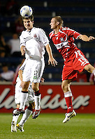 DC United defender Bobby Boswell (32) heads the ball in front of Chicago Fire forward Nate Jaqua (11).  The Chicago Fire defeated the DC United 3-0 in the semifinals of the U.S. Open Cup at Toyota Park in Bridgeview, IL on September 6, 2006..