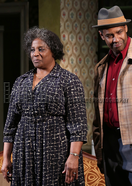 """LaTanya Richardson and Denzel Washngton during the Broadway Opening Night Curtain Call for  """"A Raisin In The Sun""""  at the Barrymore Theatre on April 3, 2014 in New York City."""