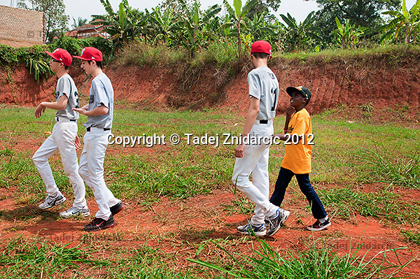 Ugandan baseball player Felix Barugahare talks to Canadian baseball player Yi An Pan during a visit to the future baseball field in Nsambya, neighbourhood of Kampala, Uganda on January 16 2012. An anonymous donor promised $35,000 needed to build the field.