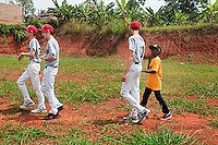 Ugandan baseball player Felix Barugahare talks to Canadian baseball player Yi An Pan during a visit to the future baseball field in Nsambya, neighbourhood of Kampala, Uganda on January 16 2012. An anonymous donor promised $35,000 needed to build the field.